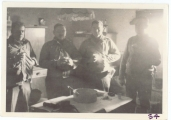 <h5>Combat</h5><p>Likely officers in a farmhouse kitchen. Identities unknown. Photo provided by the family of Elmore Willets. </p>