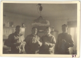 <h5>Combat</h5><p>Officers in the kitchen of a farmhouse. Captain Elmore Willets (middle right). Photo provided by the family of Elmore Willets. </p>