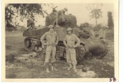 <h5>Combat</h5><p>Soldiers and child with wrecked Sherman tank (identities unknown). Photo provided by the family of Elmore Willets.</p>