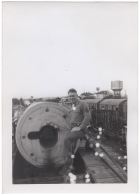 <h5>German Cannon</h5><p>Clint Stillman standing on the loading end of the massive German train cannon. Provided by the family of Ivo Schommer.</p>