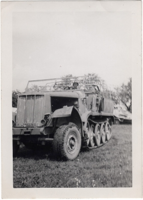 <h5>German truck</h5><p>Appears to be Clint Stillman on captured German vehicle. Provided by the family of Ivo Schommer.</p>