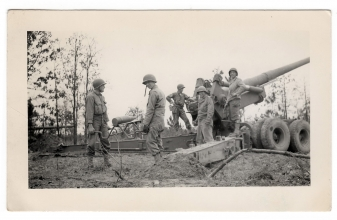 <h5>Loading Shell</h5><p>Soldiers loading a shell. Likely during training. Photo provided by family of Ivo Schommer.</p>