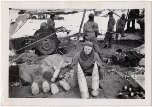 <h5>Clinton Stillman</h5><p>Clint Stillman with two 155mm shells. Photo provided by family of Ivo Schommer.</p>