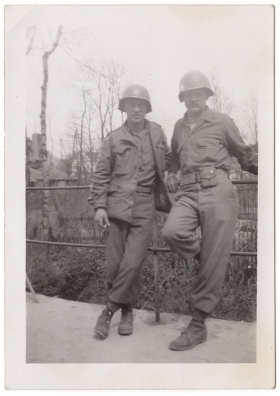 <h5>Soldiers</h5><p>Unidentified soldiers on bridge. Photo provided by family of Ivo Schommer.</p>