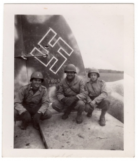 <h5>Nazi Plane</h5><p>Three soldiers pose on an enemy plane. Photo provided by family of Ivo Schommer.</p>