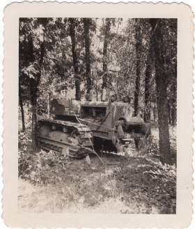 <h5>Old Tractor</h5><p>Old broken down tractor. Photo provided by family of Ivo Schommer.</p>