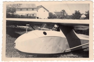 <h5>Ivo Schommer in Glider</h5><p>Ivo Schommer posing in a glider. Photo provided by family of Ivo Schommer.</p>