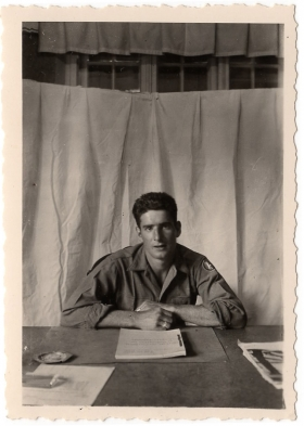<h5>Soldier</h5><p>Unidentified soldier at desk. Photo provided by family of Ivo Schommer.</p>